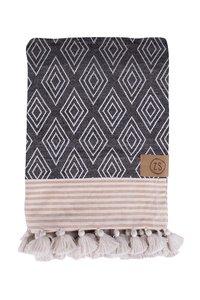 detailfoto hammam handdoek met kwastjes
